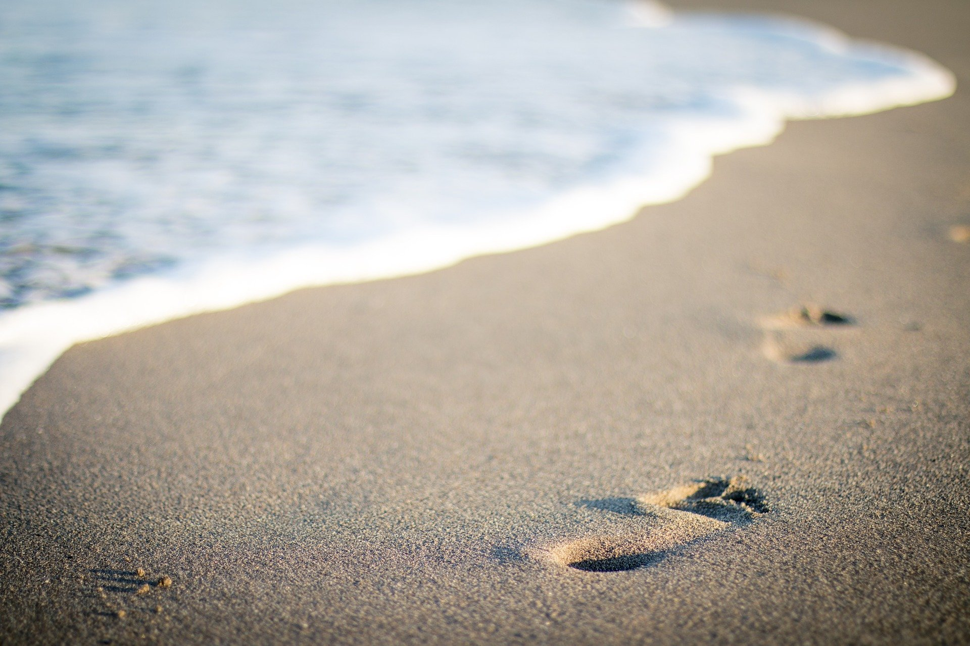 Start Living the Life You Desire. footprint. water. sea. sand. www.blisslife.in