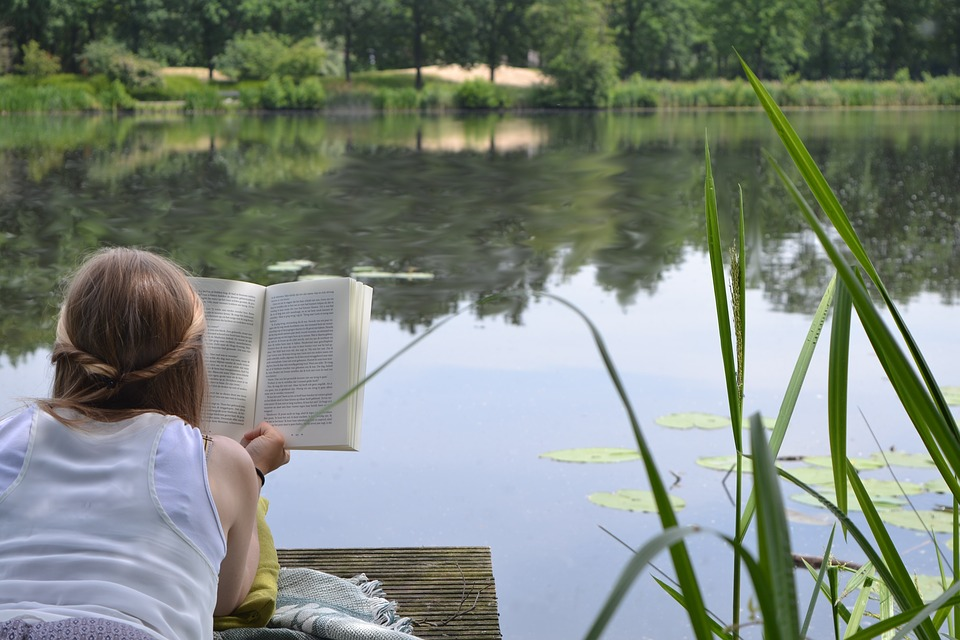 books, woman. nature. pond. reading. motivational books. www.blisslife.in