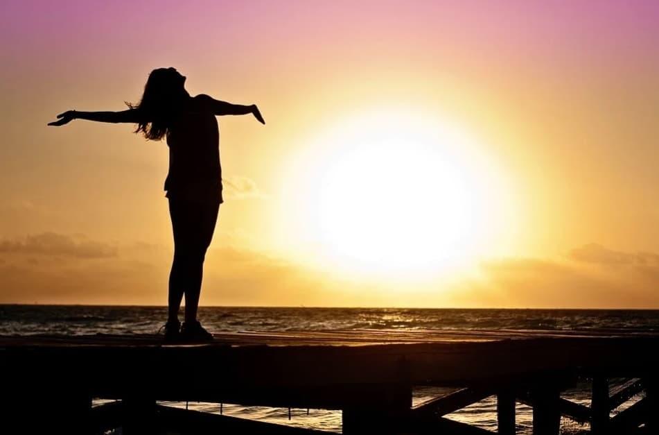 health benefits of yoga. sunlight. positive attitude. better life. seaside. evening