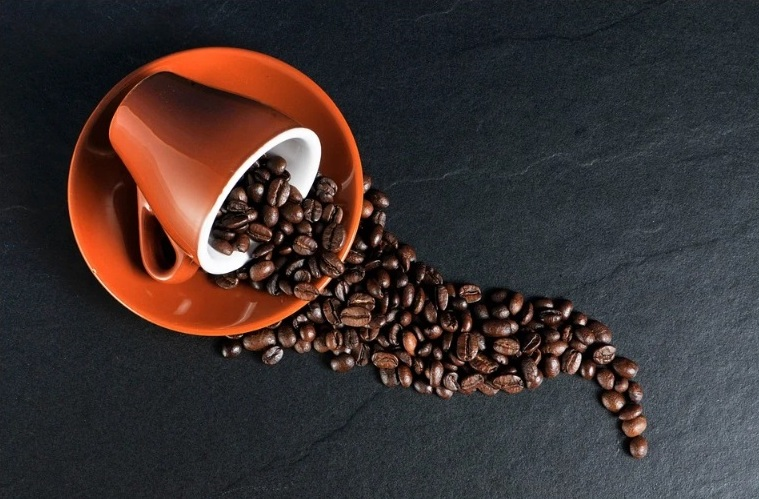 health benefits of coffee. coffee beans. cup and plate. www.blisslife.in