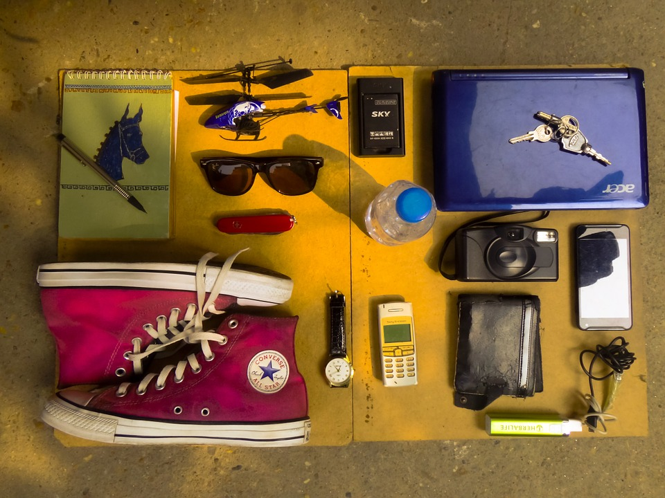 Living with Less. shoe. sunglass. books and pen. camera. phone. watch. keys. www.blisslife.in